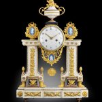 late Louis XVI ormolu and porcelain mounted white marble mantel clock with cameo of Chronos
