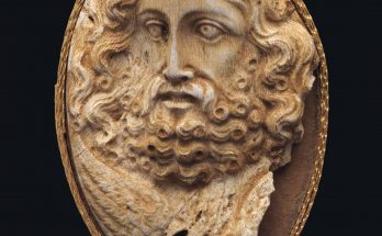 A GREEK CORAL CAMEO OF ZEUS HELLENISTIC PERIOD, CIRCA 2ND CENTURY B.C.