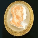 A mid-Victorian Etruscan style cameo brooch circa 1860