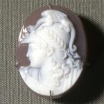 Modern gold brooch set with an agate cameo of a profile head of Mars