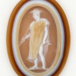 Oval sardonyx cameo in three layers: pale brown over white over brown.
