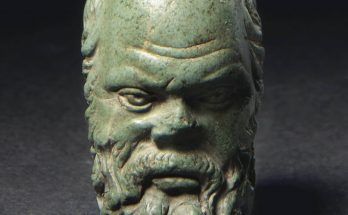 A ROMAN MINIATURE GREEN STONE PORTRAIT HEAD OF SOCRATES