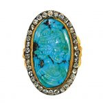 A diamond and turquoise cameo ring