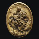 AN OVAL GILT TERRACOTTA RELIEF OF THE VIRGIN AND CHILD